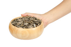 Sunflower seeds. Image of sunflower seeds in wooden bowl isolate on white background Royalty Free Stock Photography
