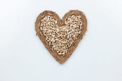 Sunflower seeds  lies at the heart made of burlap Stock Images