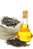 Sunflower seeds and oil in bottle. Royalty Free Stock Images