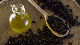 Sunflower seeds and oil close up. stock video footage
