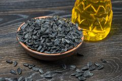 Sunflower seeds with oil. On wood background Royalty Free Stock Images