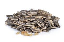 Sunflower seeds pile against white background Stock Photo
