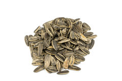 Sunflower seeds pile against white background Stock Photo