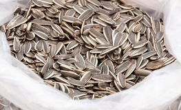 Sunflower seeds in plastic bag stock image