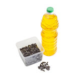 Sunflower seeds in plastic tray and bottle of sunflower oil Stock Photography
