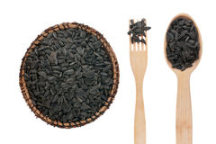Sunflower seeds in a plate, fork and spoon Royalty Free Stock Photos