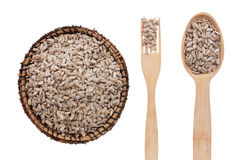 Sunflower seeds in a plate, fork and spoon Royalty Free Stock Photo