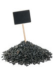 Sunflower  seeds with a pointer for your text Stock Photography