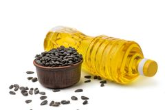 Sunflower seeds in pot bottel oil. On white background solated Stock Photo