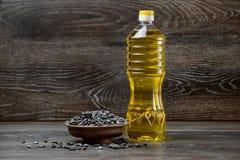 Sunflower seeds in pot bottel oil. On wood background Stock Images