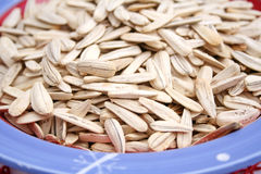 Sunflower seeds. Some dried sunflower seeds in a bowl Royalty Free Stock Photos