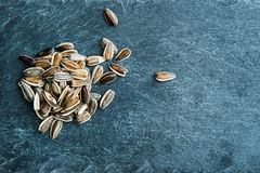 Sunflower seeds on stone substrate Stock Photos