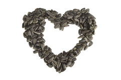 Sunflower seeds on a white background. Sunflower seeds in the form of hearts on a white background Stock Photography