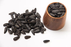 Sunflower seeds on a white background and in a wooden glass Stock Image