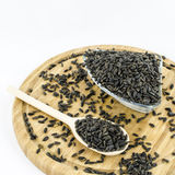 Sunflower seeds on wooden board. Healthy vegetarian food. Royalty Free Stock Photos