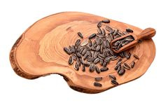 Sunflower seeds on a wooden board isolated on white background Royalty Free Stock Photos