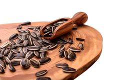 Sunflower seeds on a wooden board isolated on white background Stock Images