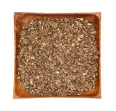 Sunflower seeds in a wooden bowl on a white background Royalty Free Stock Image