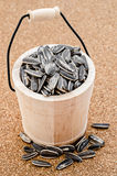 Sunflower seeds in a wooden casks. Royalty Free Stock Image