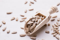 Sunflower seeds on wooden scoop Royalty Free Stock Photography