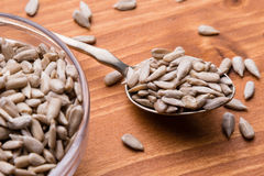 Sunflower seeds on wooden table Stock Images