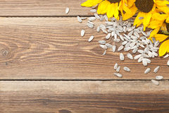Sunflower on table. Sunflowers and seed on a wooden table Stock Image