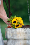 Sunflower wedding bouquet on the stone well Royalty Free Stock Photo