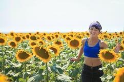 Among sunflowers. The happy girl is running on sunflower field in Moldova Stock Photo