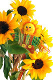 Sunflowers. Fabric scarecrow together fresh sunflowers and dry ears of wheat Stock Photo