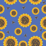 Sunflowers on a blue background. Seamless pattern. Design for textiles, tapestries, glassware, ceramics, packaging material Royalty Free Stock Photos