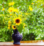 Sunflowers in Blue Pitcher Stock Photography