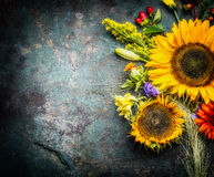 Sunflowers bunch on dark vintage background, top view Royalty Free Stock Photos