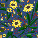 Sunflowers and leaves on a blue background. Seamless texture with sunflowers and leaves on a blue background Royalty Free Stock Photos