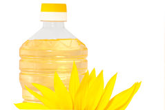 Sunflowers  and oil. Sunflowers and  bottle with sunflower oil isolated on white background Royalty Free Stock Photography