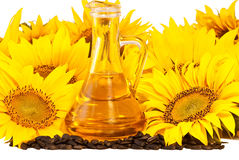 Sunflowers, oil and seeds. Isolated on white background Royalty Free Stock Photography