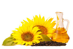 Sunflowers, oil and seeds. Isolated on white background Royalty Free Stock Images