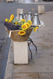 Sunflowers and pewter work for sale. At the weekly market in Vaison la Romaine, France Stock Photos