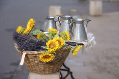 Sunflowers and pewter work for sale. At the weekly market in Vaison la Romaine, France Royalty Free Stock Images