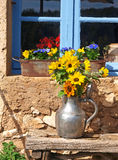 Sunflowers in Provence. Sunflowers in a pewter pitcher at a farmhouse in Provence Royalty Free Stock Photos