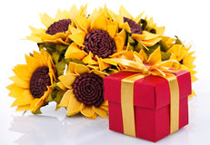 Sunflowers and red gift box Stock Image