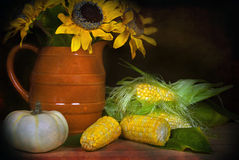 Sunflowers with sweet corn. Fall sunflower bouquet with pumpkin and corn Royalty Free Stock Image