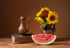 Sunflowers in a vase and fresh watermelon Royalty Free Stock Images