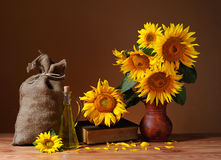 Sunflowers in a vase and a sack of jute Royalty Free Stock Photography