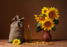 Sunflowers in a vase and a sack of jute Stock Photos