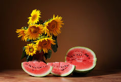Sunflowers in a vase and watermelon Royalty Free Stock Photo