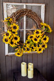 Sunflowers on a wicker wreath window Royalty Free Stock Images