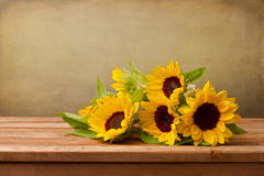Sunflowers on wooden table Stock Photos