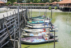 Sungai Dorani, Selangor 02 Mac 2016 : Concrete jetty and fishing boats Royalty Free Stock Photo
