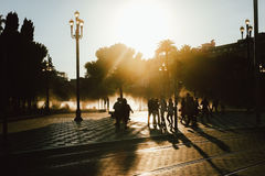 Sunglare Photo of Children on Street Royalty Free Stock Photo