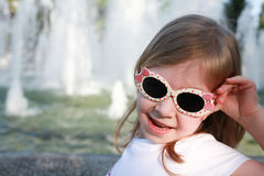 Sunglases for little girl Stock Images
